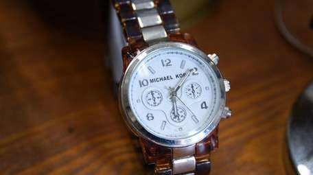 A Michael Kors watch carried a $25 price