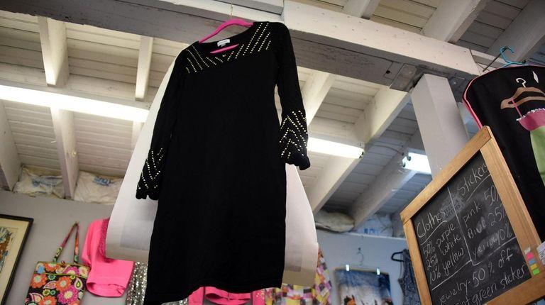 A black Calvin Klein dress has a $20