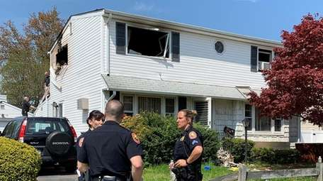 Police at the scene of a Hicksville house