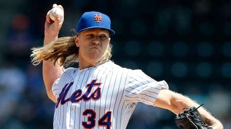 Mets pitcher Noah Syndergaard delivers during the first