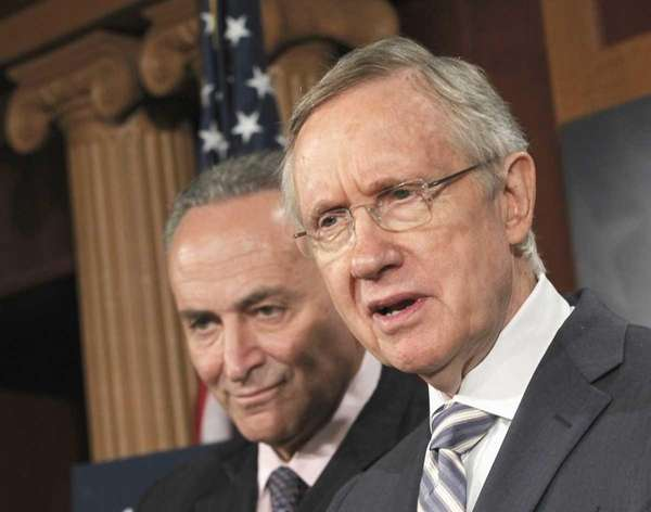 Senate Majority Leader Harry Reid of Nev., right,