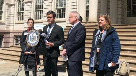 State Sen. Brad Hoylman, center, and Assemb. Jeffrey