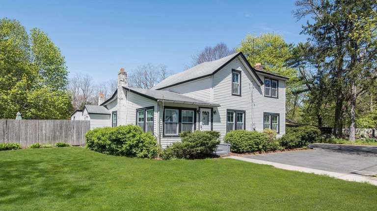This two-acre Coram property is listed for $379,000.