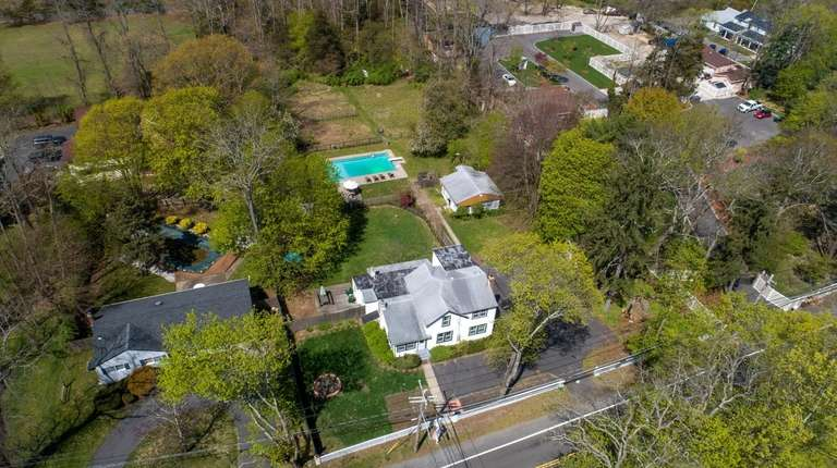 This two-acre Coram property features a four-bedroom Colonial