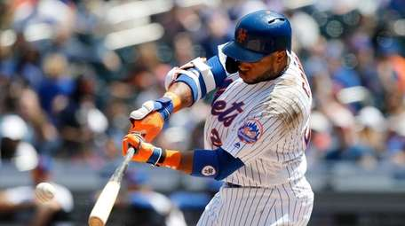 Robinson Cano #24 of the Mets connects on