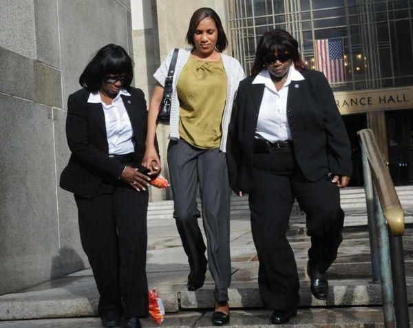 Nafissatou Diallo, center, leaves Manhattan criminal court. (July