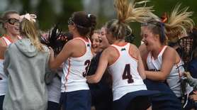 Manhasset teammates celebrate after their 12-11 overtime win