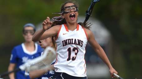 Emma LoPinto of Manhasset reacts after scoring the