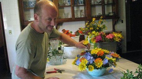 Scott Lucas creates floral arrangements using flowers he