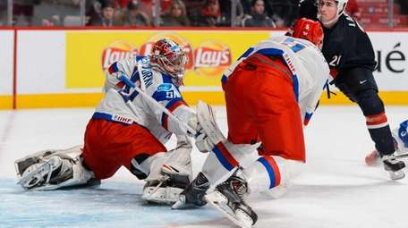 Igor Shesterkin of Team Russia stretches to make