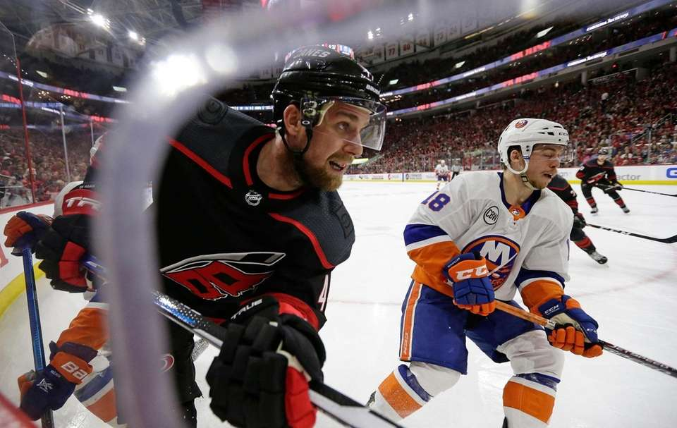 Carolina Hurricanes' Calvin de Haan, left, and New