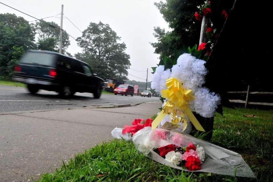 A makeshift memorial at scene where Erika Hughes,