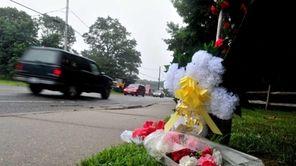 A makeshift memorial at scene where Erika Hughes,