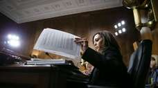 Sen. Kamala Harris (D-Calif.) goes over notes before