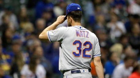 The Mets' Steven Matz adjusts his cap after