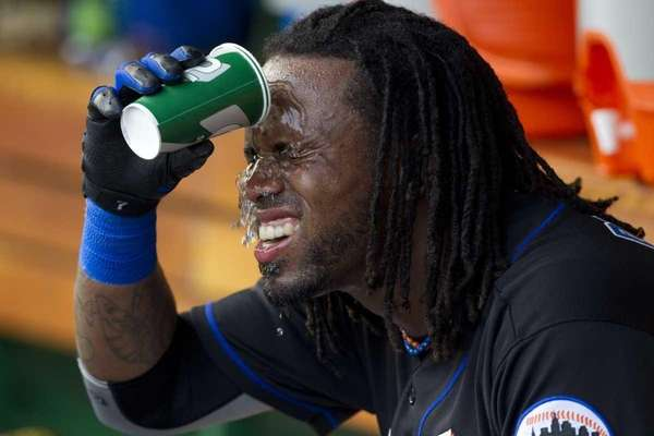 Jose Reyes cools off before the start of