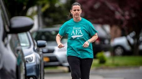 Peggy McHugh trains Friday near her Wantagh home