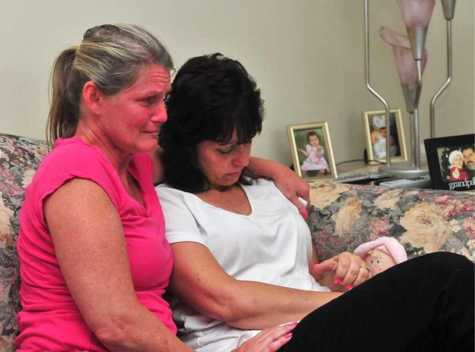 Lori Hughes, right, mother of Erika Hughes, is
