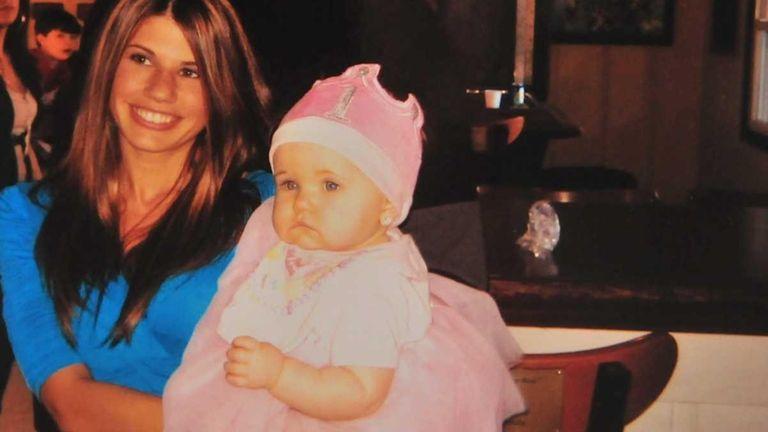 Erika Hughes, 24, of Shirley, seen holding her