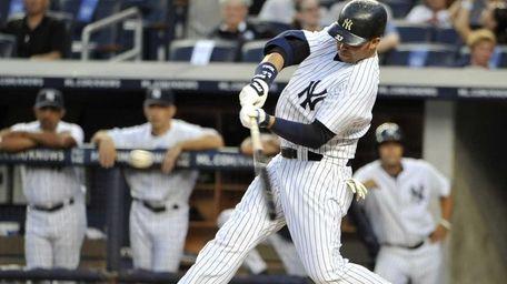 New York Yankees' Nick Swisher hits a two-run