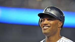 Robinson Cano smiles as he comes out of