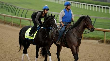 Kentucky Derby entrant Long Range Toddy, left, is