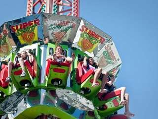 Children ride the Super Shot ride during the