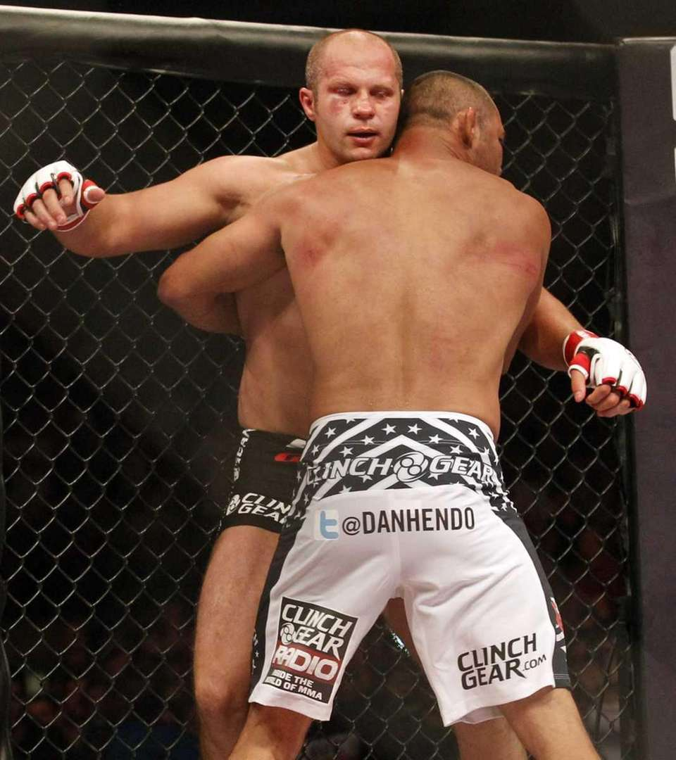 Fedor Emelianenko, left, tries to hit Dan Henderson,