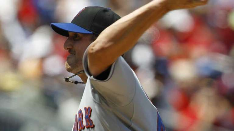 New York Mets pitcher Jon Niese delivers to