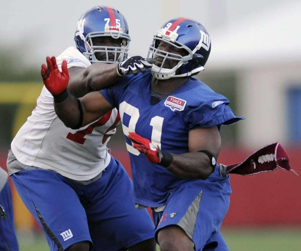 New York Giants tackle Jarriel King, left, attempts