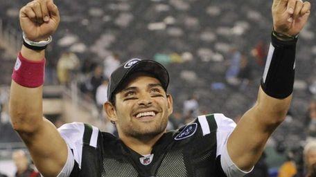 New York Jets quarterback Mark Sanchez gestures to