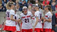 Stony Brook players congratulate Taryn Ohlmiller #21 after