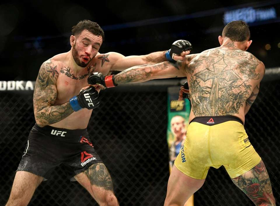 Cub Swanson, right, fights with Shane Burgos in