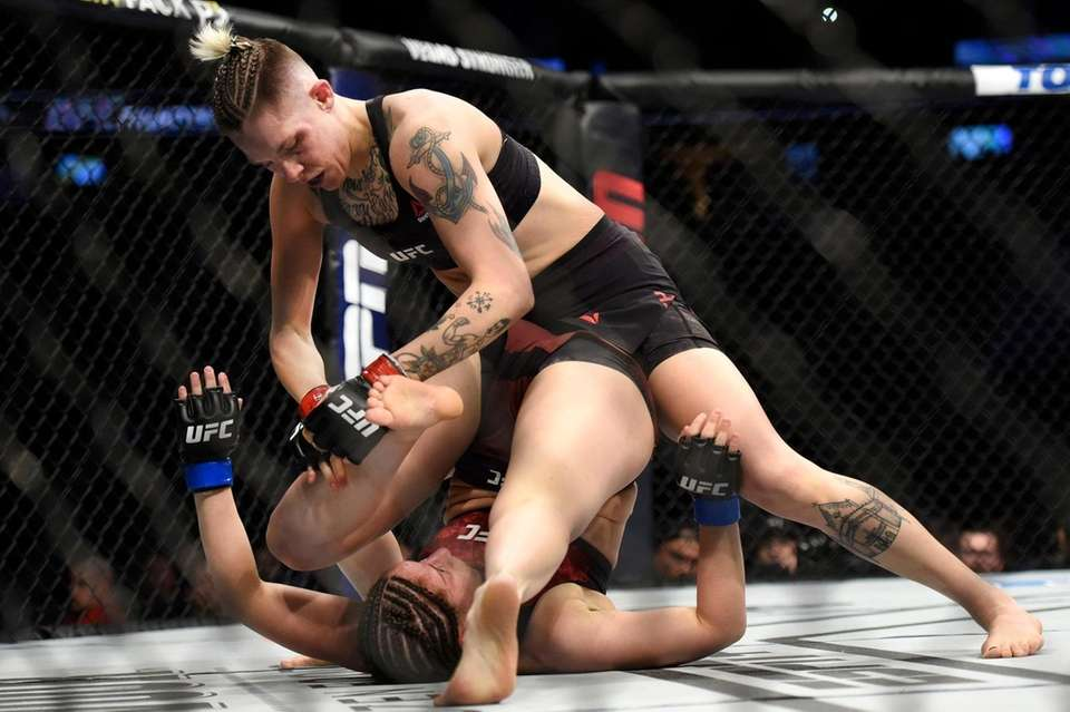 Macy Chiasson, top, fights Sarah Moras in the