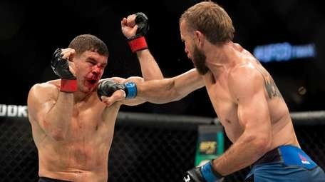 Donald Cerrone, right, punches Al Iaquinta during a