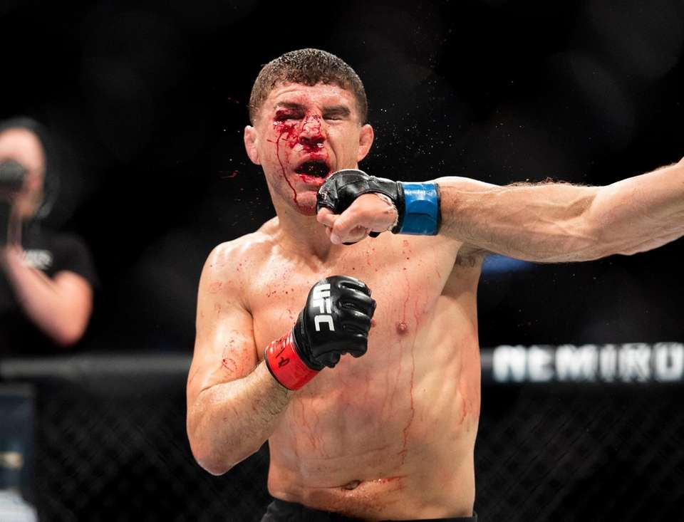 Al Iaquinta is punched by Donald Cerrone during