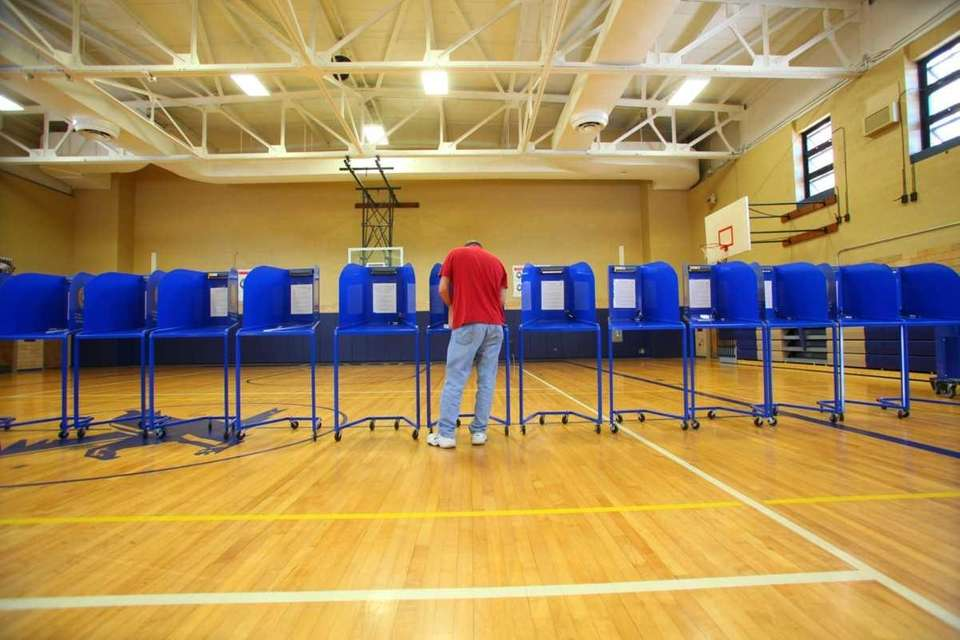 Turnout looks light as a Nassau resident casts
