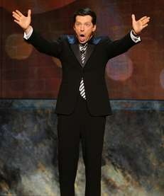 Host Sean Hayes speaks onstage during the 64th