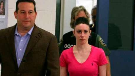 Casey Anthony (R) and attorney Jose Baez./Getty Images