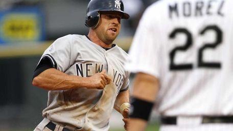 New York Yankees' Brett Gardner rounds third to