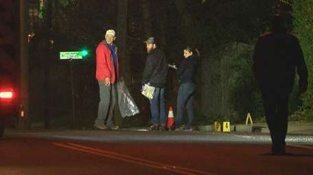 Investigators at the crash scene on Herkimer Street