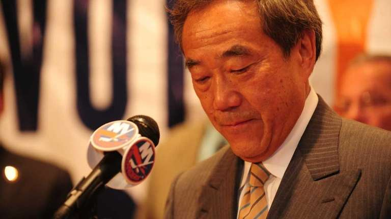 Charles Wang addresses media and supporters after the