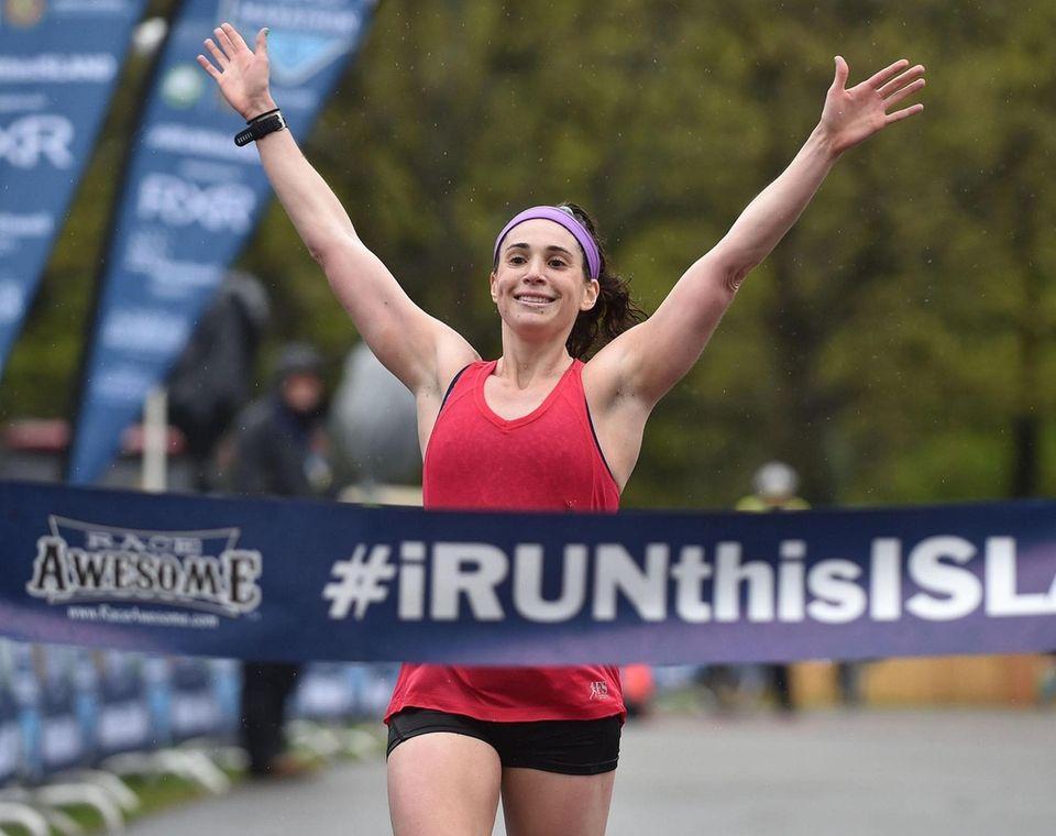 Lori Brown wins the women's half-marathon race on