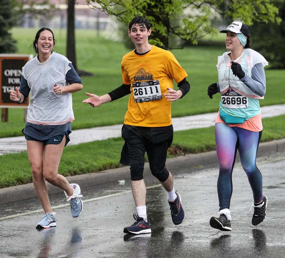 Runners enjoy the rain on Merrick Avenue in