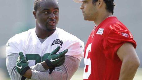 New York Jets quarterback Mark Sanchez, right, talks