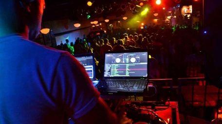 DJ Young K spins inside the Crazy Donkey