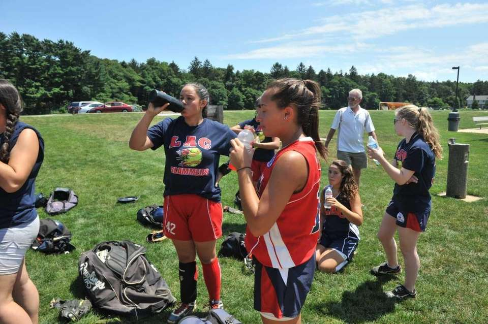 Members of the Levittown Slammers hydrate themselves after