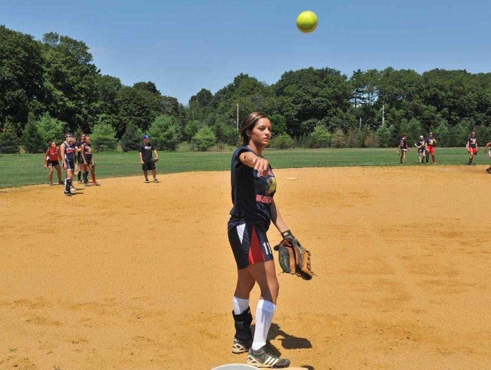 Sabrina Gordek tosses a ball during practice at