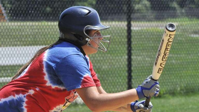 Kim Nowak practices bunting during batting practice. (July