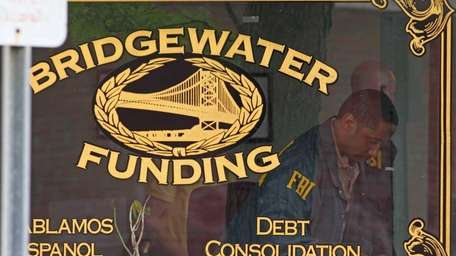Federal agents gather evidence inside of Bridgewater Funding